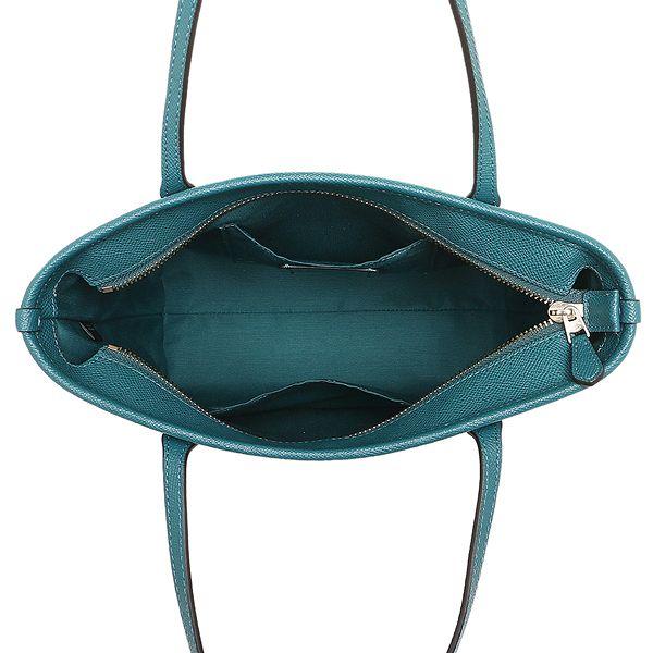 9e680eae375c COACH 經典馬車素色托特包(小/藍綠)F22967. COACH代表美式時尚最為人稱道的創新風格與傳統工藝,以簡潔、耐用的風格特色贏得消費者的喜愛,其產品保持著上等的用料和  ...