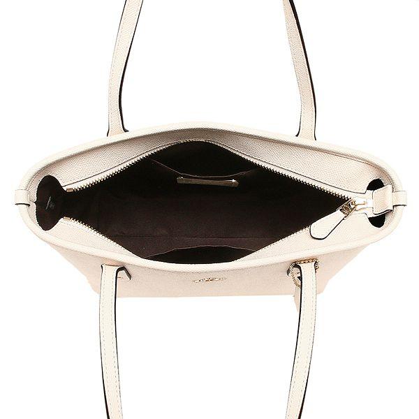 adfc106f678a COACH 經典馬車素色托特包(小/白)F22967. COACH代表美式時尚最為人稱道的創新風格與傳統工藝,以簡潔、耐用的風格特色贏得消費者的喜愛,其產品保持著上等的用料和工藝  ...